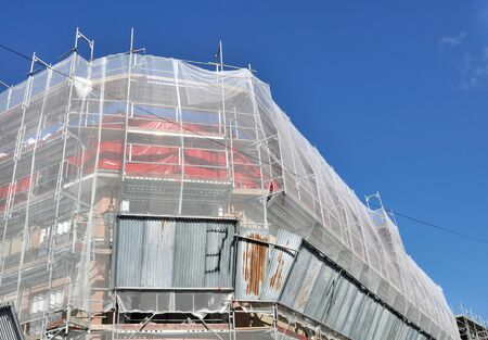 tarpaulin: Scaffolding on a building with tarpaulin