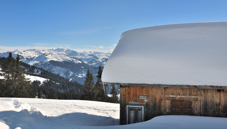 mountain hut: mountain hut on the snow-covered roof