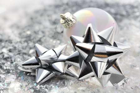 nodes: silver nodes and Christmas ball on confetti Stock Photo