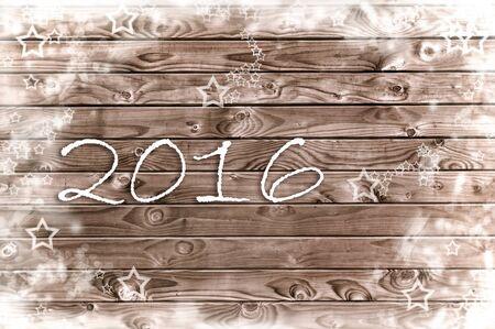 Neues Jahr 2016 auf einer Holzplatte mit weißen Sternen Standard-Bild - 48296184