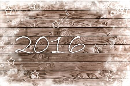 new year 2016 on a wooden panel with white stars Фото со стока