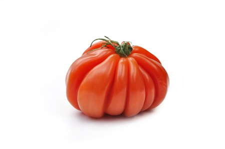 beautiful large-fruited beef tomato isolated on white background