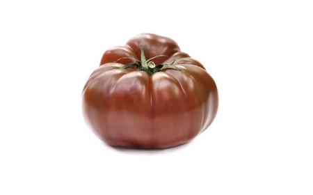 Crimea zwarte tomaten op een witte achtergrond Stockfoto