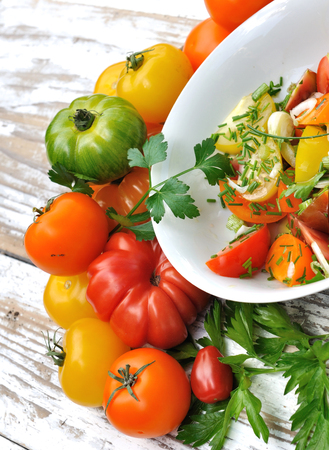 aromatic: plate of tomato salad with aromatic herb Stock Photo