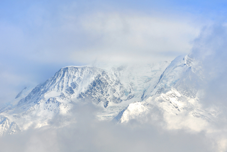 mont: view of Mont Blanc through the clouds in winter