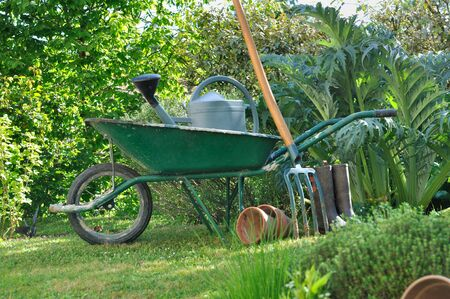 wheelbarrow: wheelbarrow and gardening tools