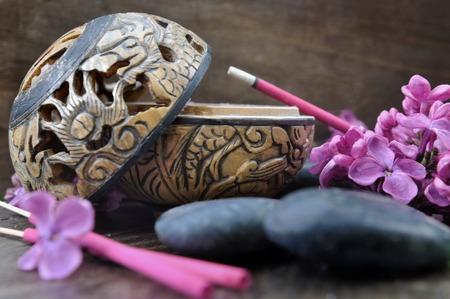 wood burner: incense burner with sticks lilac perfume on wooden background Stock Photo