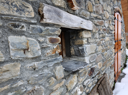 lintel: stone cottage with a small window in Savoy Stock Photo