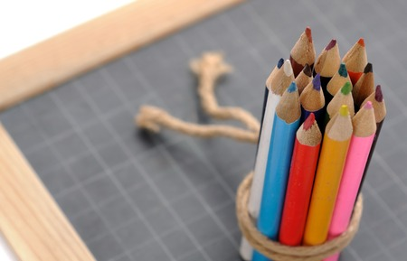 stringed: colored pencils stringed on a slate