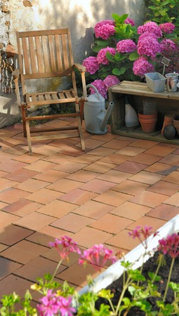 terracotta: patio flowered with terracotta tiles