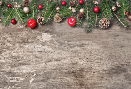 bordering: Christmas ornament bordering an old wooden plank