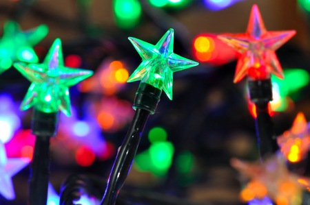 leds: colorful lights star shaped of a electic garland Foto de archivo