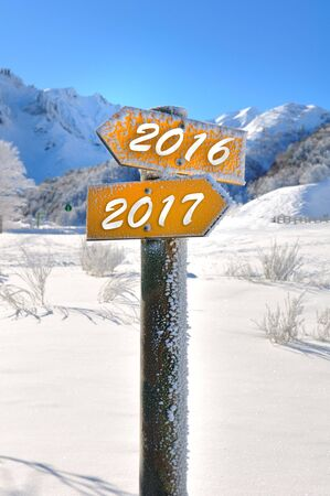2016 and 2017 on two panels mountain overlooking the opposite direction Stock Photo
