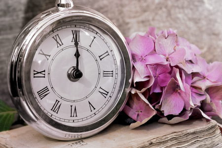 midnight: retro clock showing midnight in rustic background Stock Photo