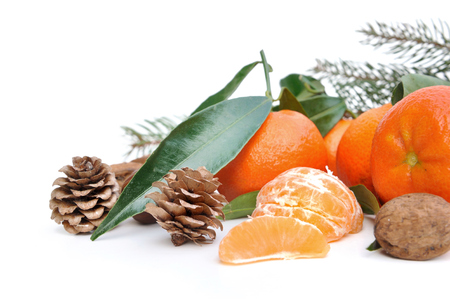 clementine fruit: clementines with leaf and pine cones on white background