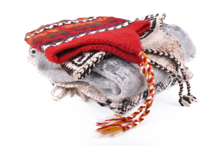 peruvian woolen hat on pullover isolated on white background Фото со стока