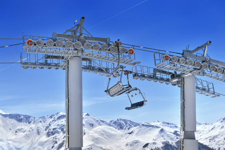 empty chair lift skiing empty chair lift above snowy mountain and under blue sky stock photo 111835772 empty chair lift above snowy mountain and under blue sky