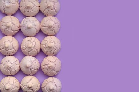 top view on meringues arranged on colored background with copy space on the right
