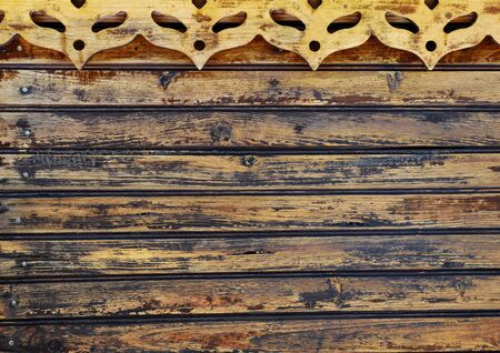 wooden background with old vanished boards and cut out carnival masks Фото со стока