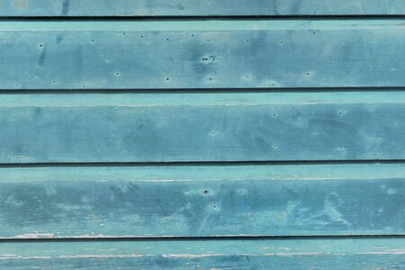 close on blue  wooden board of  a cottage outdoor facade Фото со стока