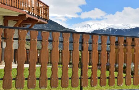 close on wooden fence of an alpine cottage in  mountain
