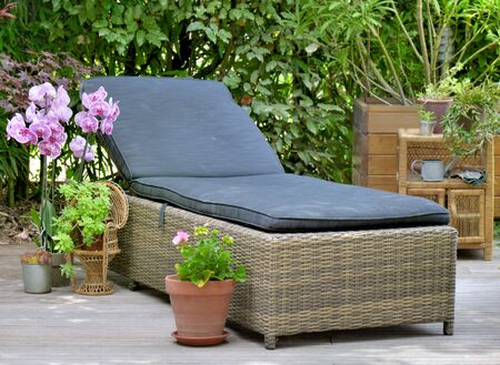 wicker sunbath in wooden terrace for relaxing in  home garden