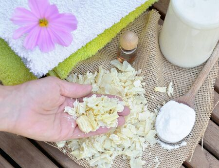 pieces of soap in a hand of a  woman to homemade laundry