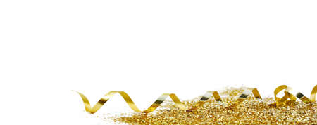 ribbon curling and golden confetti on white background in panoramic view Reklamní fotografie
