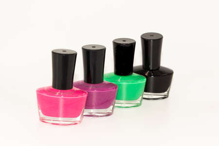 Shallow depth of field image of Four bottles of colored nail polish kept on display with white background Zdjęcie Seryjne