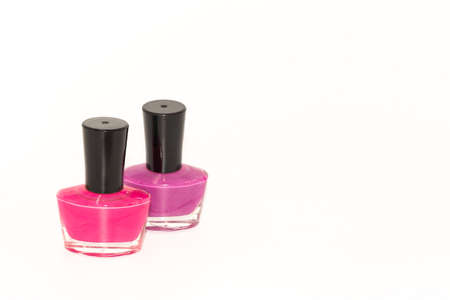 Shallow depth of field image of  bottles of colored nail polish kept on display with white background Zdjęcie Seryjne