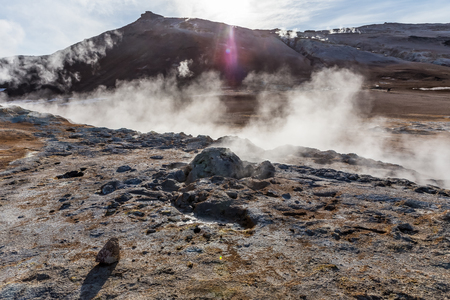 sulfur: Hot springs and fumaroles produce steam and sulfur vapors on the slope of Mt. Namafjall in Northeastern Iceland. Stock Photo