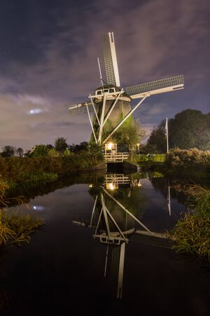 amstel: De Riekermolen is a historic polder drainage windmill from 1636 on the bank of the River Amstel in Amsterdam. Stock Photo