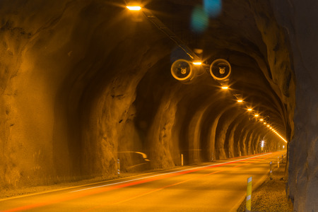 Tunnel with lights and trails of car traffic. This underground passageway connects Faskrudsfjordur and Reydarfjordur in East Iceland