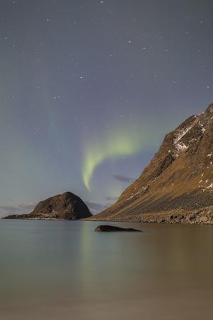 Northern lights over Haukland beach on Lofoten, Norway