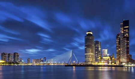 rotterdam: Rotterdam skyline during the blue hour. With the Erasmus bridge, Holland-America Line, New orleans and the Montevideo Buildings on Kop van Zuid. Stock Photo