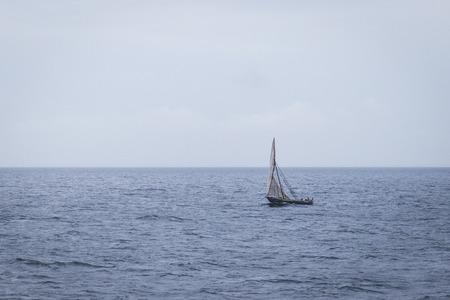 ocean fishing: Dhow wooden boat sailing on the Indian Ocean near Zanzibar, Tanzania