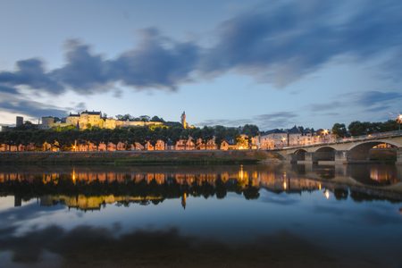 chinon: Chinon village, located along the river Vienne in the Loire valley, during dusk. On top of the mountain is the medieval Chinon castle