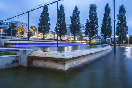 plein: Modern concrete water art structure with illumination at night at Zoetermeer, the Netherlands. Stock Photo