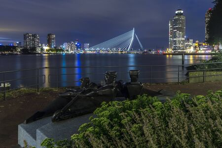 Rotterdam city skyline at night. Shot from the dockside the city centre skyline is clearly visible on the backdrop Stock Photo