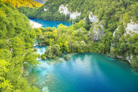 Colorful aerial scenic view on the forest, trees, landscape, blue water lakes and waterfalls of Plitvice lakes, Croatia Stock Photo