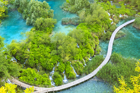 Colorful aerial scenic view on the forest, trees, landscape, walking path over blue water lakes and waterfalls of Plitvice lakes, Croatia Banco de Imagens