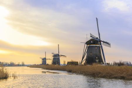 Beautiful three windmills in a Dutch winter landscape at the Driemolengang Driemanspolder near the cities Leidschendam and Zoetermeer.
