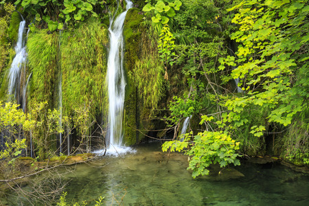 Close up of blue waterfalls in a green forest during daytime in Summer.Plitvice lakes, Croatia Banco de Imagens