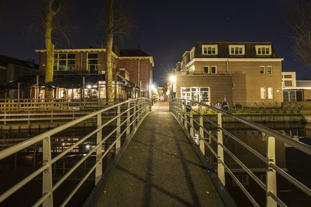 Street view at night on old historic shopping district dorpsstraat Zoetermeer city, no people. Stockfoto