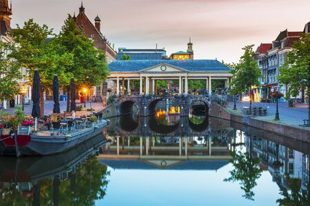 Historical, touristic Dutch town Leiden city hall koornbrug and canals during dusk Фото со стока - 132063297