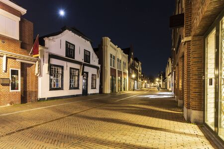 Street view at night on old historic shopping district dorpsstraat Zoetermeer city, no people. Фото со стока - 132062601
