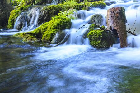 Close up of blue waterfalls in a green forest during daytime in Summer.Plitvice lakes, Croatia Фото со стока