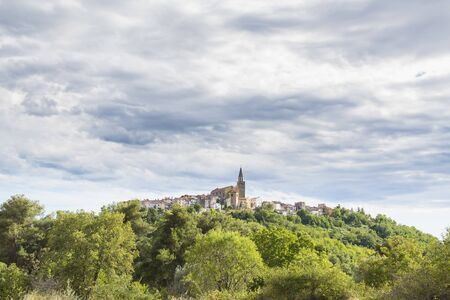View on the medieval village Buje in Croatia on a also known as the sentinel of Istria for its hilltop site. The town developed from a Roman and Venetian settlement into a medieval town. Фото со стока