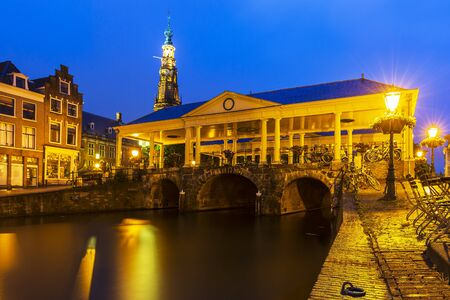 Historical, touristic Dutch town Leiden city hall koornbrug and canals during dusk