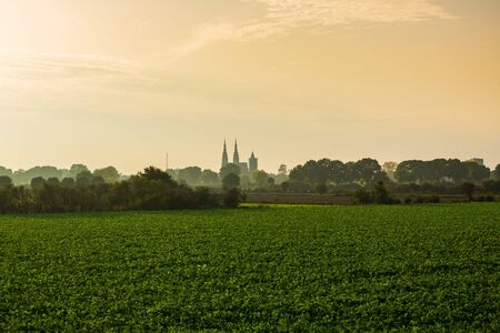 Land van Cuijk, agricultural landscape at the small village Cuijk and the Meuse river, the Netherlands under a blue sky. Popular touristic landmark for travel Фото со стока - 133512716